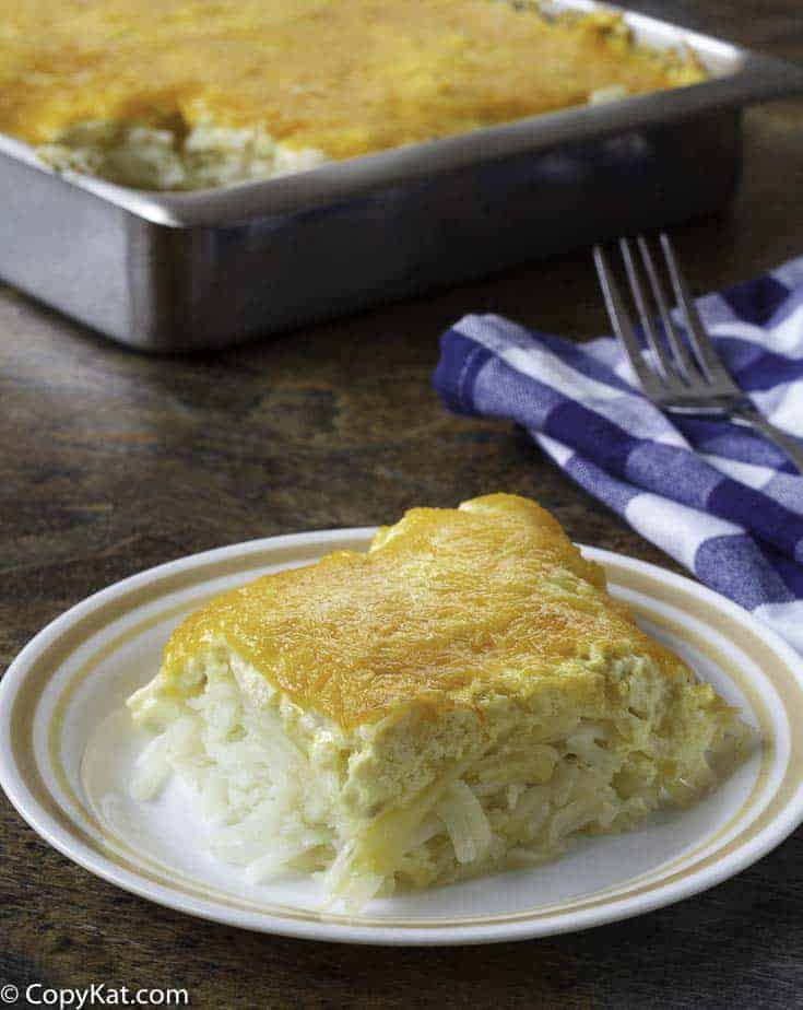 cheesy hashbrown casserole in a baking dish.