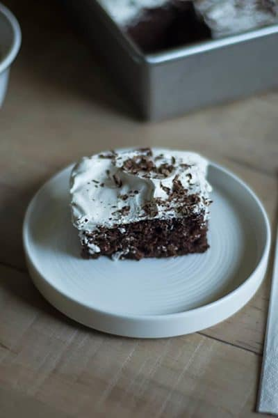 This Better Than Sex Cake is the perfect combination of chocolate cake, caramel syrup, and whipped cream. #cake #chocolate #caramel