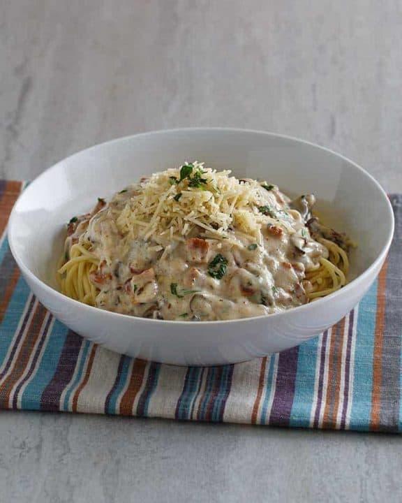 a bowl of homemade spaghetti pasta carbonara