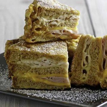 Homemade Bennigan's Monte Cristo Sandwich slices on a plate