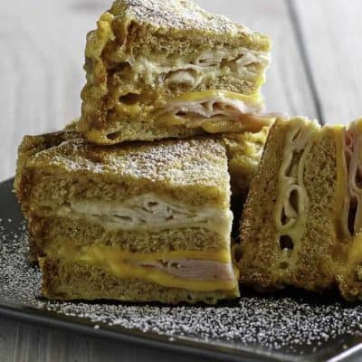 Create the classic Bennigan's Monte Cristo Sandwich at home with this classic copycat recipe. #montecristo #sandwich #bennigans #copycat #copycatrecipe