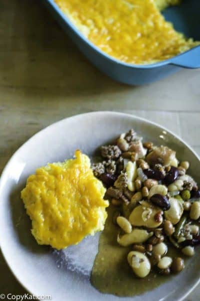 A pan of creamed corn casserole, and a plate with a piece of creamed corn casserole with beans.