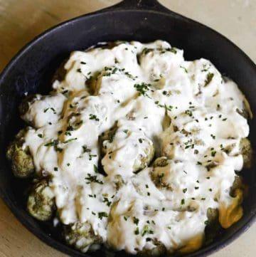 meatballs in creamy mushroom sauce in a skillet