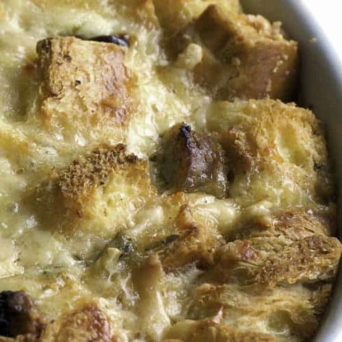 a bowl of bread pudding with raisins