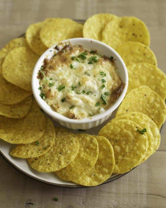 hot crab dip and tortilla chips on a platter