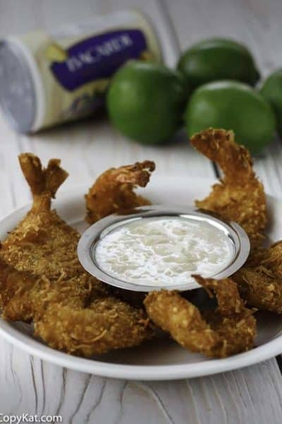 Coconut shrimp with pina colada dipping sauce on a plate