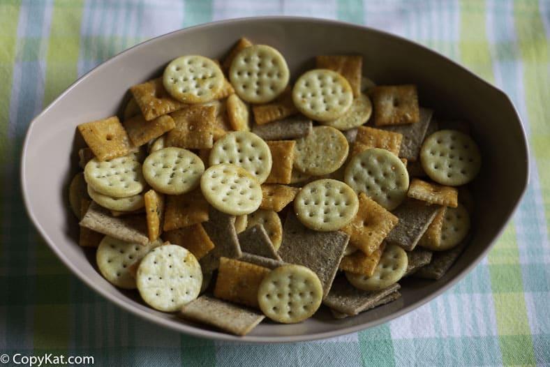 A bowl of seasoned crackers.