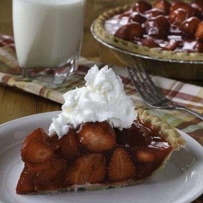 Slice of homemade copycat Shoney's strawberry pie on a white plate.