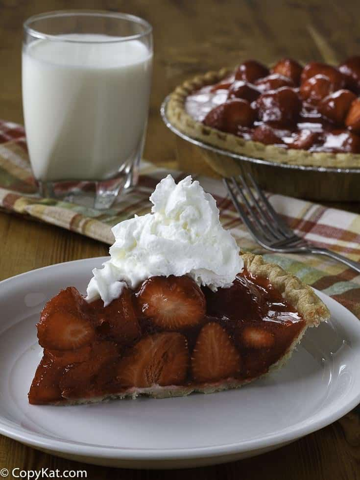 Slice of homemade copycat Shoney's strawberry pie on a white plate.