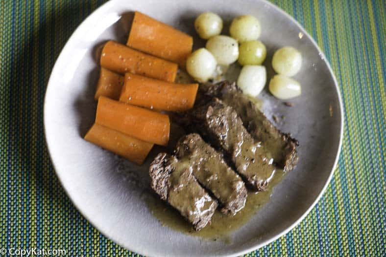 Yankee Pot Roast with Carrots and Onions on a plate.