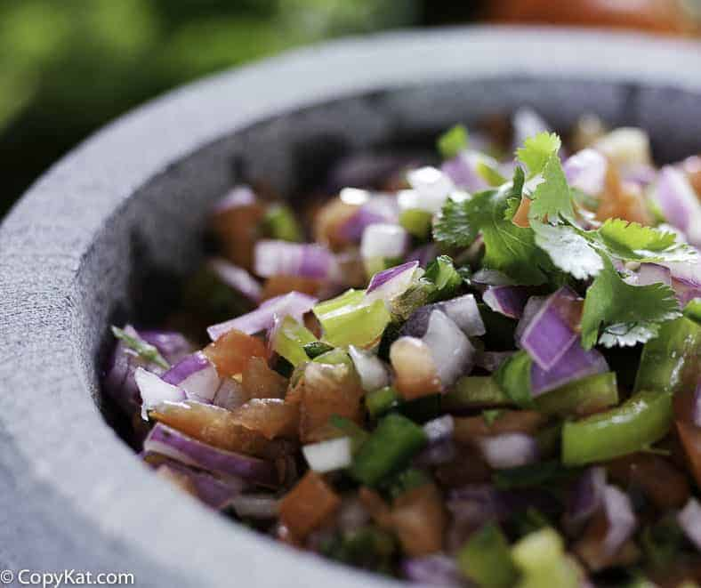 pico de gallo in a grey bowl