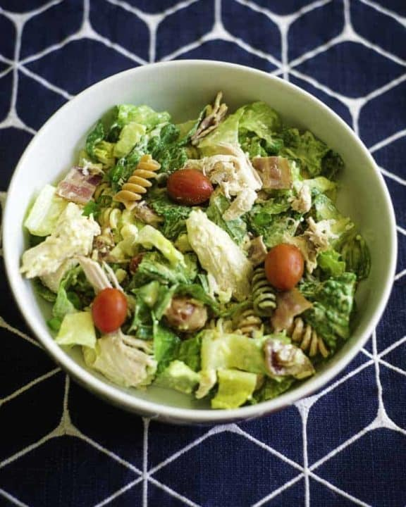 A chicken and lettuce salad with honey mustard dressing.