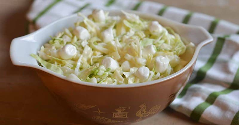 Pineapple marshmallow coleslaw in a serving dish