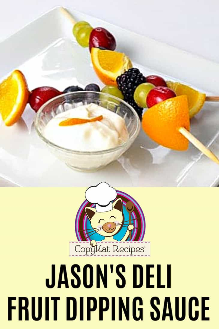 A bowl of homemade Jason's Deli Creamy Fruit Dip and fruit skewers on a serving platter.