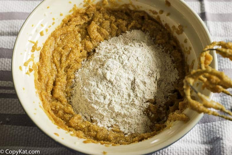 adding flour to the pumpkin batter