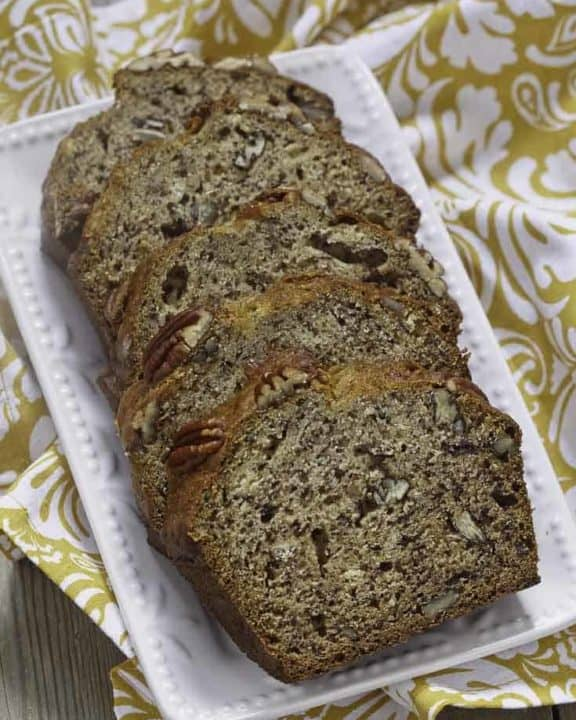 4 slices of banana bread with pecans on a plate