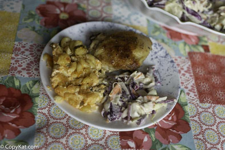 A plate with Famous Dave's Coleslaw baked chicken and macaroni and cheese