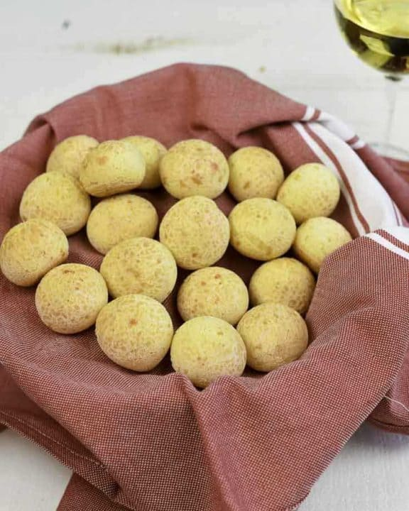 A basket filled with Brazilian cheese bread puffs