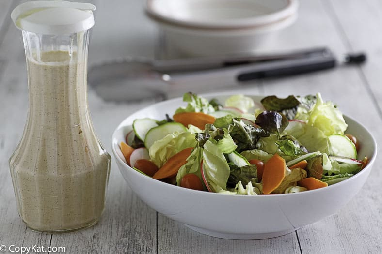 Make Houston's Buttermilk Garlic Salad dressing at home with this copycat recipe.  This salad dressing is the perfect addition to your dinner.