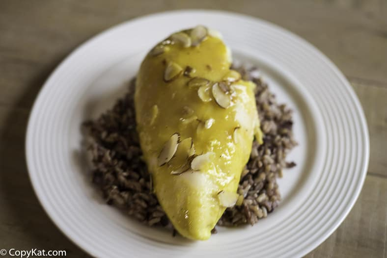 A chicken breast made with a lemon sauce and topped with slivered almonds.