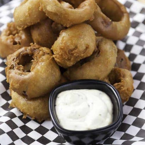 You can make Simon and Seaforts Beer Battered Onion Rings at home with this easy copycat recipe.