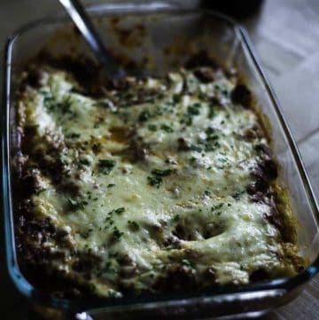 Stuffed Manicotti is made with cheese, and served with a meat sauce.