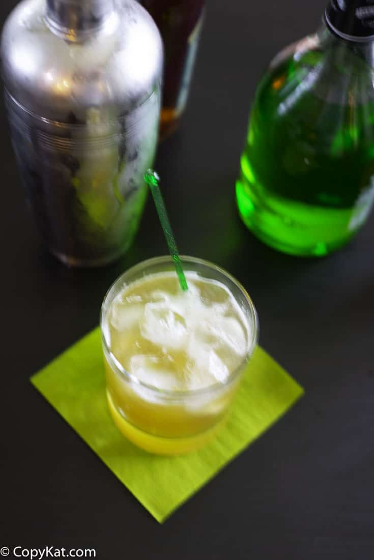 A Washington Apple cocktail, pictured with a cocktail shaker and apple pucker.