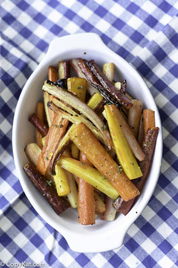 Honey and Thyme roasted carrots are so delicious and so easy to put together.  Try this easy recipe today.
