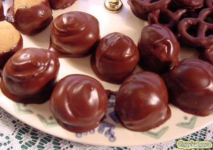 chocolate covered peanut butter balls on a plate
