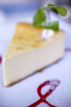 Slice of cheesecake on a plate.