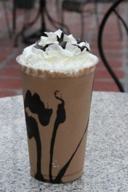 Iced Mocha topped with whipped cream in a glass.
