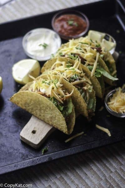 Four homemade Taco Bell Tacos on a platter.