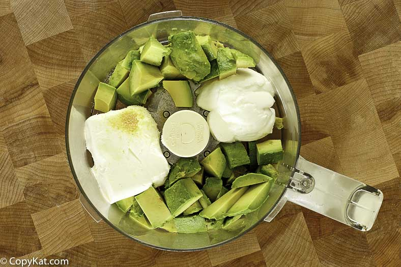 Mixing together salsa verde in a food processor
