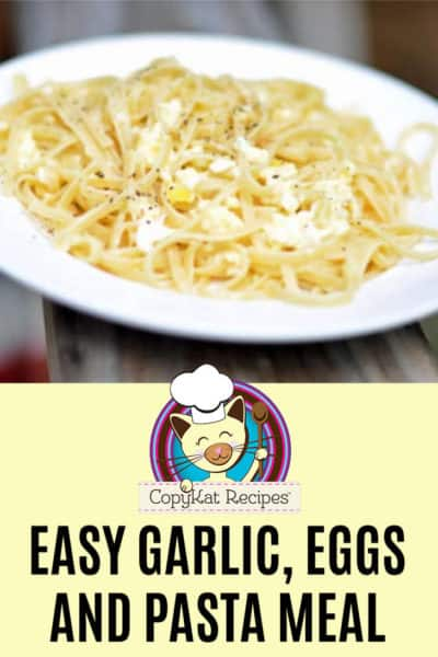 A plate of garlic, eggs, and pasta