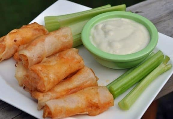 buffalo chicken spring rolls, celery, and blue cheese dressing