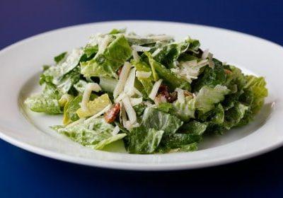 bowl of caesar salad dressing