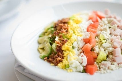 cobb salad in a white bowl