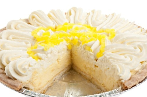 coconut cream pie with piece missing