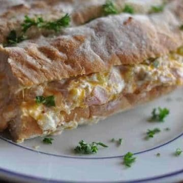 Mississippi Sin bread stuffed with cheese, cream cheese, ham and more.