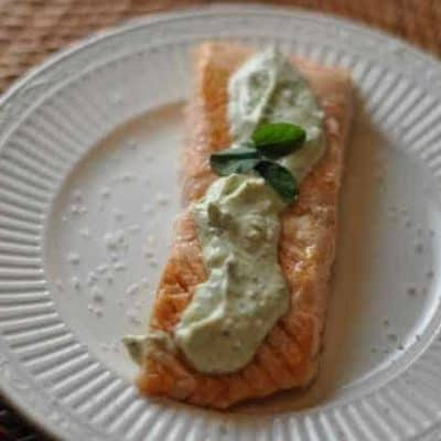 Grilled salmon is served with a wonderful savory cream cheese sauce.