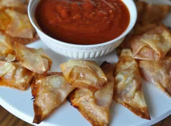 pizza won tons and sauce on a plate