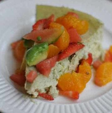 Slice of Avocado Cheesecake with fruit salsa