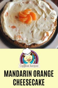 mandarin orange cheesecake on a white platter