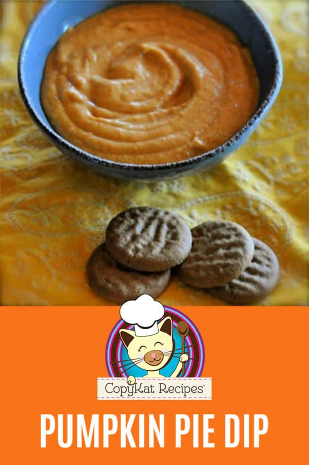Pumpkin pie dip in a bowl next to gingersnap cookies