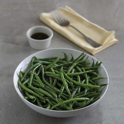Homemade copycat Outback Steakhouse Steamed Green Beans in a white bowl.