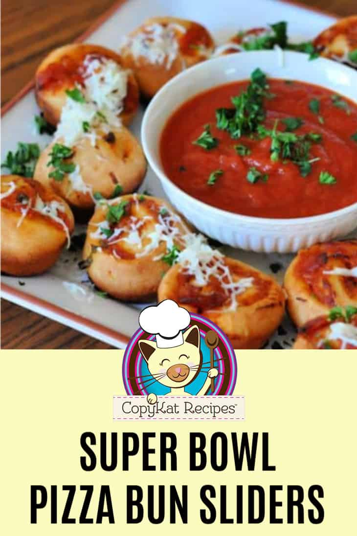 Super Bowl Pizza Bun Sliders and marinara sauce on a platter.