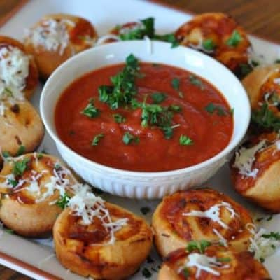 pizza bun sliders and marinara sauce on a plate.
