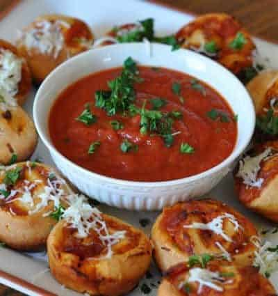 pizza bun sliders and marinara sauce on a plate.
