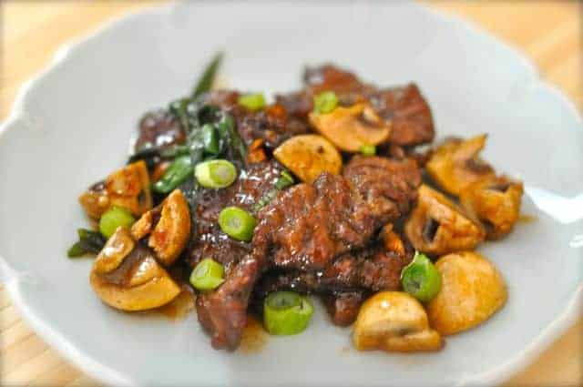 Mongolian beef with mushrooms on a plate