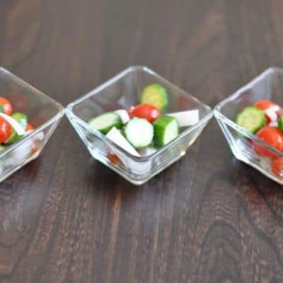 3 bowls of tomato, cucumber, and onion salad